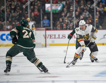 Vegas Golden Knights center Ryan Carpenter, right, tries to skate past Minnesota Wild defenseman Mathew Dumba (24) in the first period during an NHL hockey game, in St. Paul, Minn. The Knights won 2-1 in a shootout