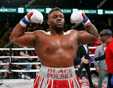 Jarrell Miller celebrates after defeating Tomasz Adamek, of Poland, during a heavyweight boxing match, in Chicago