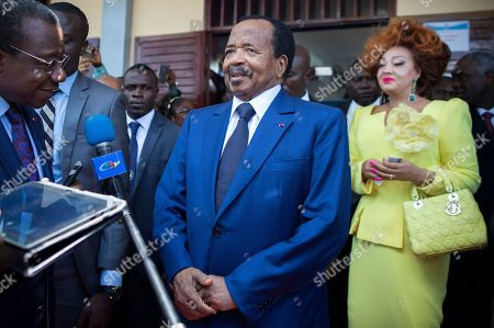 Cameroon President Paul Biya (C) speaks to the media next to his wife Chantal Biya (R)  after casting his ballot in the presidential elections at a polling station in the capital Yaounde, Cameroon, 07 October 2018. The incumbent President Paul Biya is Africa's oldest president who has been in power for 36 years. He faces eight candidates with 6.9 million registered voters. Relations between the government and marginalised anglophone separatists in the North West and South West of the country is a major issue threatening peace and stability in Cameroon.