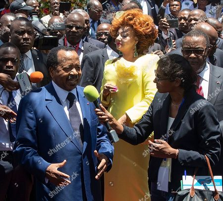 Cameroon president Paul Biya (L) and his wife Chantal Biya (C) speak to the media after casting their ballots in the presidential elections at a polling station in the capital Yaounde, Cameroon, 07 October 2018. Incumbent president Paul Biya is Africa's oldest president and has been in power for 36 years. He faces eight candidates with 6.9 million registered voters. Relations between the government and marginalized Anglophone separatists in the North West and South West of the country is a major issue threatening peace and stability in Cameroon.