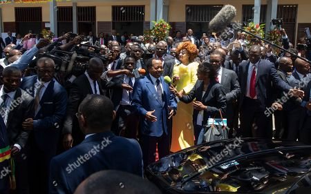 Cameroon president Paul Biya (C-L) and his wife Chantal Biya (C-R) speak to the media after casting their ballots in the presidential elections at a polling station in the capital Yaounde, Cameroon, 07 October 2018. Incumbent president Paul Biya is Africa's oldest president and has been in power for 36 years. He faces eight candidates with 6.9 million registered voters. Relations between the government and marginalized Anglophone separatists in the North West and South West of the country is a major issue threatening peace and stability in Cameroon.
