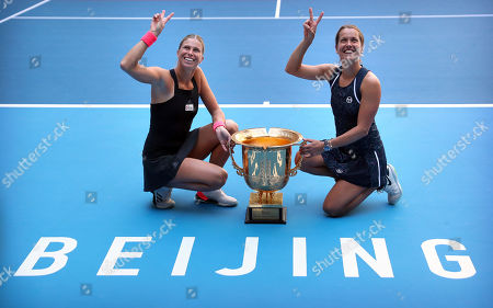 Andrea Sestini Hlavackova, left, and Barbora Strycova of the Czech Republic pose with the winner's trophy after beating Gabriela Dabrowski of Canada and Xu Yifan of China in the women's doubles final in the China Open at the National Tennis Center in Beijing