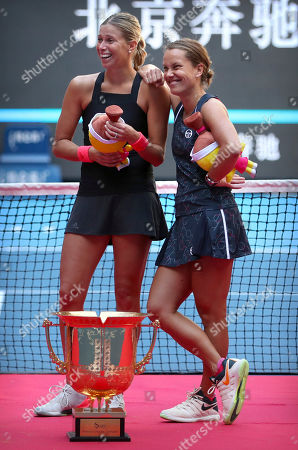 Andrea Sestini Hlavackova, left, and Barbora Strycova of the Czech Republic stand with the winner's trophy after beating Gabriela Dabrowski of Canada and Xu Yifan of China in the women's doubles final in the China Open at the National Tennis Center in Beijing