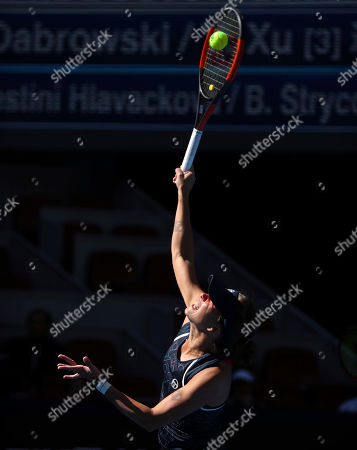 Barbora Strycova of the Czech Republic serves while competing with her partner Andrea Sestini Hlavackova of the Czech Republic against Gabriela Dabrowski of Canada and Xu Yifan of China in the women's doubles final in the China Open at the National Tennis Center in Beijing