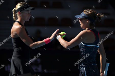 Andrea Sestini Hlavackova, left, and Barbora Strycova of the Czech Republic react while competing against Gabriela Dabrowski of Canada and Xu Yifan of China in the women's doubles final in the China Open at the National Tennis Center in Beijing
