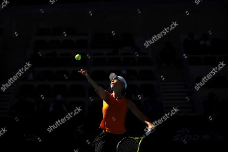 Xu Yifan of China serves while competing with her partner Gabriela Dabrowski of Canada against Andrea Sestini Hlavackova and Barbora Strycova of the Czech Republic in the women's doubles final in the China Open at the National Tennis Center in Beijing