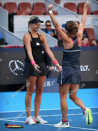 Stock Photo of Andrea Sestini Hlavackova, left, and Barbora Strycova of the Czech Republic react after beating Gabriela Dabrowski of Canada and Xu Yifan of China in the women's doubles final in the China Open at the National Tennis Center in Beijing