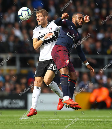 Maxime Le Marchand of Fulham and Alexandre Lacazette of Arsenal in action