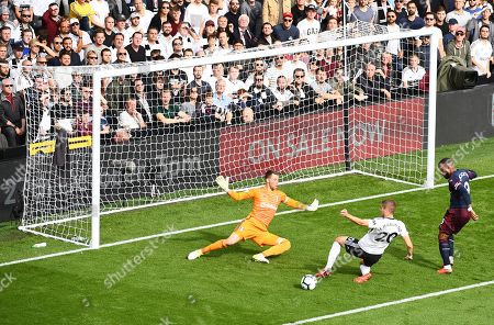 Maxime Le Marchand of Fulham denies Alexandre Lacazette of Arsenal with a last ditch clearance