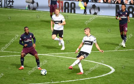 Maxime Le Marchand of Fulham and Alexandre Lacazette of Arsenal