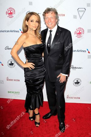 US actress Lisa LoCicero and British filmmaker Nigel Lythgoe arrive for the 2018 Carousel of Hope Ball at The Beverly Hilton in Beverly Hills, California, USA, 06 October 2018 (issued 07 October 2018). The event raises funds for the Barbara Davis Center for Diabetes.