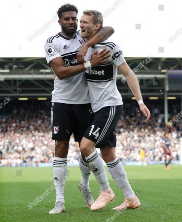 Fulham's Andre Schuerrle,right, celebrates with Fulham's Cyrus Christie after scoring his side's first goal during the English Premier League soccer match between Fulham and Arsenal at Craven Cottage stadium in London