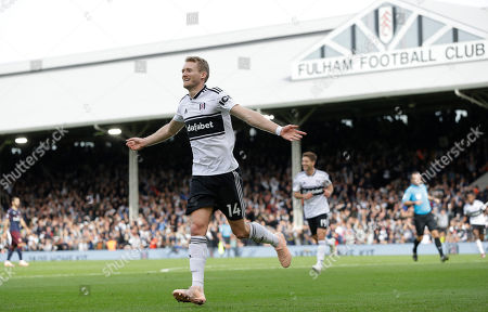 Fulham's Andre Schuerrle celebrates scoring his side's first goal during the English Premier League soccer match between Fulham and Arsenal at Craven Cottage stadium in London