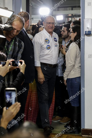 Geraldo Alckmin (C), candidate for the Presidency of Brazil for the Brazilian Social Democracy Party (PSDB), attends the polling station to vote in Sao Paulo, Brazil, 07 October 2018. A total of 147.3 million Brazilian voters are called to elect their next president in a two-round election in which Brazilian socialist Fernando Haddad and extreme right-winger Jair Bolsonaro are the two main candidates are contesting to become the new leader of the country. The second round of the presidential election will be held on 28 October.