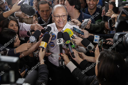 Stock Picture of Geraldo Alckmin (C), candidate for the Presidency of Brazil for the Brazilian Social Democracy Party (PSDB), attends the polling station to vote in Sao Paulo, Brazil, 07 October 2018. A total of 147.3 million Brazilian voters are called to elect their next president in a two-round election in which Brazilian socialist Fernando Haddad and extreme right-winger Jair Bolsonaro are the two main candidates are contesting to become the new leader of the country. The second round of the presidential election will be held on 28 October.