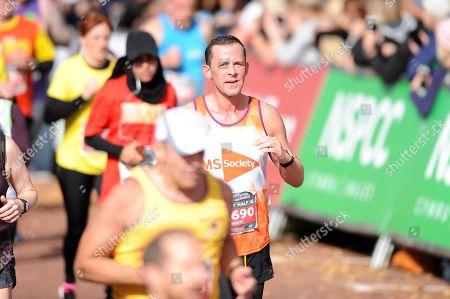 BBC Radio 1 DJ Scott Mills finishes Cardiff Half Marathon.