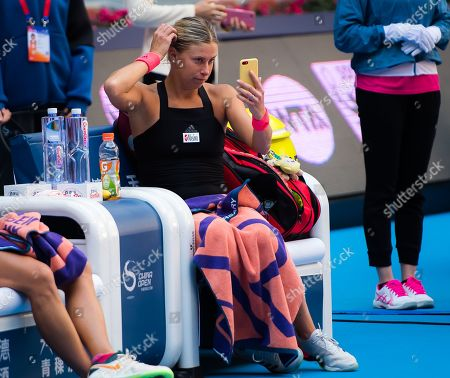 Andrea Hlavackova & Barbora Strycova of the Czech Republic prepare for the trophy ceremony after the doubles final