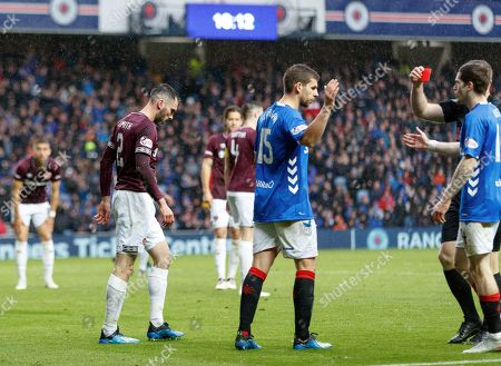 Michael Smith of Heart of Midlothian sent off by Referee John Beaton for a second yellow offence when he fouled Jon Flanagan of Rangers on the edge of the penalty box.