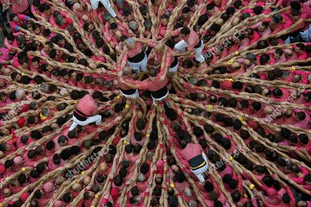 """Members of the """"Colla Vella dels Xiquests de Valls"""" try to complete their human tower during the 27th Human Tower Competition in Tarragona, Spain, on . The tradition of building human towers or """"castells"""" dates back to the 18th century and takes place during festivals in Catalonia, where """"colles"""" or teams compete to build the tallest and most complicated towers. """"Castells"""" were declared by UNESCO one of the Masterpieces of the Oral and Intangible Heritage of Humanity"""