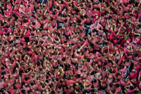 """Members of the """"Colla Vella dels Xiquests de Valls"""" celebrate after completing their human tower during the 27th Human Tower Competition in Tarragona, Spain, on . The tradition of building human towers or """"castells"""" dates back to the 18th century and takes place during festivals in Catalonia, where """"colles"""" or teams compete to build the tallest and most complicated towers. """"Castells"""" were declared by UNESCO one of the Masterpieces of the Oral and Intangible Heritage of Humanity"""