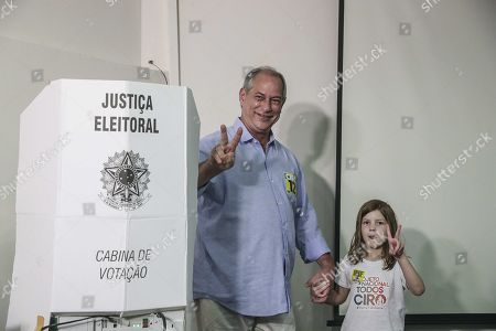 Brazilian presidencial candidate of the Labor Democratic Party (PDT) Ciro Gomes (L) in the company of his granddaughter Maria Clara (R) gestures after casting his vote in Fortaleza, Brazil, 07 October 2018. A total of 147.3 million Brazilian voters are called to elect their next president in a two-round election in which Brazilian socialist Fernando Haddad and extreme right-winger Jair Bolsonaro are the two main candidates are contesting to become the new leader of the country. The second round of the presidential election will be held on 28 October.
