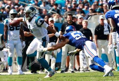 Carolina Panthers' Cam Newton (1) is tackled by New York Giants' Connor Barwin (53) in the first half of an NFL football game in Charlotte, N.C