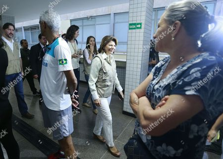 The head of the OAS Observer Mission in Brazil, former Costa Rican president Laura Chinchilla (C), visits a voting center in Brasilia, Brazil, 07 October 2018. A total of 147.3 million Brazilian voters are called to elect their next president in a two-round election in which Brazilian socialist Fernando Haddad and extreme right-winger Jair Bolsonaro are the two main candidates are contesting to become the new leader of the country. The second round of the presidential election will be held on 28 October.