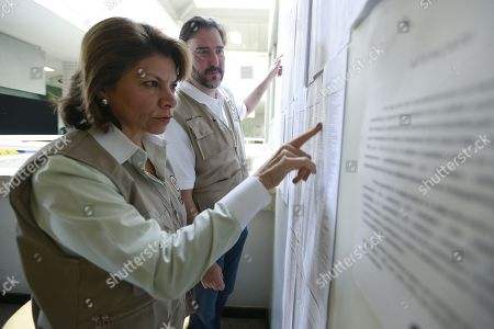 The head of the OAS Observer Mission in Brazil, former Costa Rican president Laura Chinchilla (L), visits a voting center in Brasilia, Brazil, 07 October 2018. A total of 147.3 million Brazilian voters are called to elect their next president in a two-round election in which Brazilian socialist Fernando Haddad and extreme right-winger Jair Bolsonaro are the two main candidates are contesting to become the new leader of the country. The second round of the presidential election will be held on 28 October.