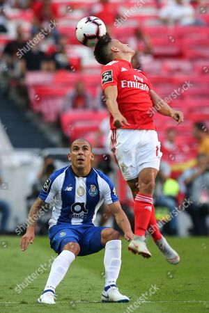 Benfica's Franco Cervi (R) fights for the ball with Maxi Pereira of FC Porto during the Portuguese First League soccer match between Benfica Lisbon and FC Porto held at Luz stadium, Lisbon, Portugal, 07 October 2018.