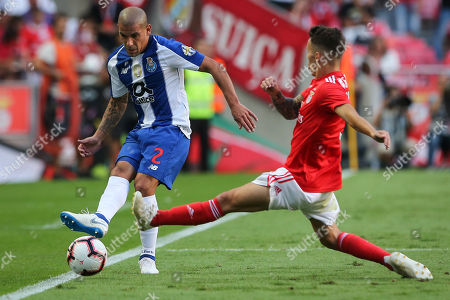 Benfica's Franco Cervi (R) fights for the ball with Maxi Pereira of FC Porto during their Portuguese First League soccer match held at Luz stadium, Lisbon, Portugal, 7th October 2018.