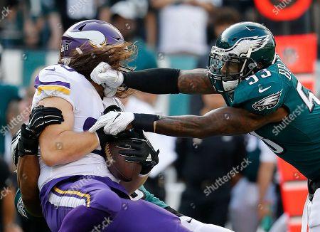 Minnesota Vikings tight end David Morgan is hit by Philadelphia Eagles linebacker Nigel Bradham during an NFL football game, in Philadelphia