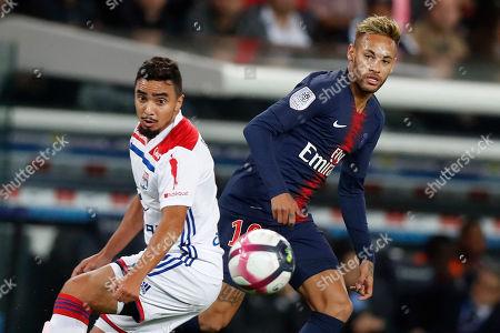 Paris Saint Germain's Neymar Jr (R) in action with Lyon's Rafael Da Silva during  the French Ligue 1 soccer match between Paris Saint-Germain (PSG) and Olympique Lyon at the Parc des Princes stadium in Paris, France, 07 October 2018.