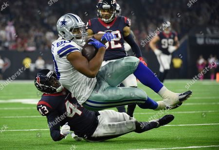 Rico Gathers, Shareece Wright. Dallas Cowboys tight end Rico Gathers (80) is hit by Houston Texans defensive back Shareece Wright (43) after a catch during the first half of an NFL football game, in Houston