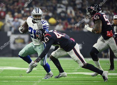 Ezekiel Elliott, Shareece Wright. Dallas Cowboys running back Ezekiel Elliott (21) is hit vy Houston Texans defensive back Shareece Wright (43) during the first half of an NFL football game, in Houston