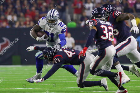 Dallas Cowboys running back Ezekiel Elliott (21) stiff arms Houston Texans defensive back Shareece Wright (43) during the first quarter in the NFL football game between the Houston Texans and the Dallas Cowboys at NRG Stadium in Houston, TX