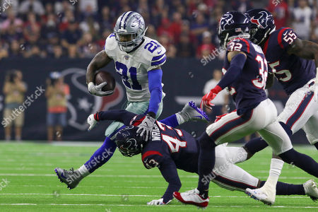 Dallas Cowboys running back Ezekiel Elliott (21) runs as he is tripped up by Houston Texans defensive back Shareece Wright (43) during the first quarter in the NFL football game between the Houston Texans and the Dallas Cowboys at NRG Stadium in Houston, TX