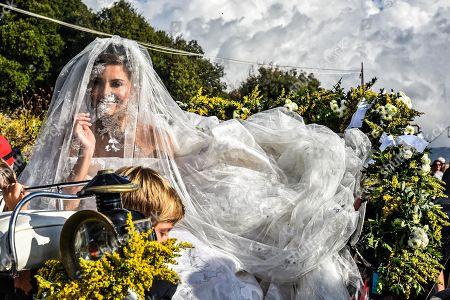 Maria Menounos on a horse-drawn carriage en route to the church