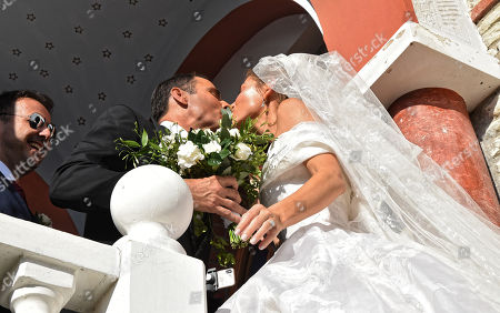 Maria Menounos with her husband Keven Undergaro kiss on the steps of the church
