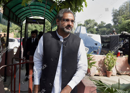 Pakistan's former prime minister Shahid Khaqan Abbasi arrives to appear in a court in Lahore, Pakistan, . Pakistan's former Prime Minister Nawaz Shari is in court again, this time on treason charges for comments he made earlier this year, claiming militants had crossed from Pakistan into India to carry out the deadly 2008 Mumbai terror attacks. Abbasi is also on trial in the same case as Sharif