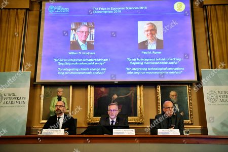 From L-R Per Strömberg, professor, Göran K. Hansson and Per Krusell announce the laureates of the Nobel Prize in Economics during a press conference at the The Royal Swedish Academy of Sciences in Stockholm, 08 Ocktober 2018. The Nobel committee announced the Nobel Prize in Economic Sciences has been awarded jointly to William D. Nordhaus (L on screen) of Yale University, New Haven, USA and Paul M. Romer (R on screen) of NYU Stern School of Business, New York, USA.