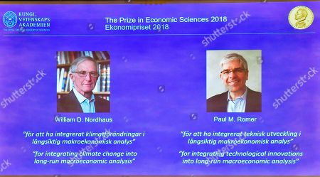 An image taken off-screen showing William D. Nordhaus (L) of Yale University, New Haven, USA and Paul M. Romer (R) of NYU Stern School of Business, New York, USA, during the announcing of the laureates of the Nobel Prize in Economics 2018 during a press conference at the The Royal Swedish Academy of Sciences in Stockholm, 08 Ocktober 2018. The Nobel committee announced the Nobel Prize in Economic Sciences has been awarded jointly to William D. Nordhaus of Yale University, New Haven, USA and Paul M. Romer of NYU Stern School of Business, New York, USA.