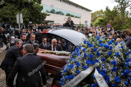 Montserrat Caballe's coffin is carried by burial services workers, during her funeral at the municipal mortuary in Barcelona, Spain, . Caballe, a Spanish opera singer renowned for her bel canto technique and her interpretations of the roles of Rossini, Bellini and Donizetti died on Saturday. She was 85