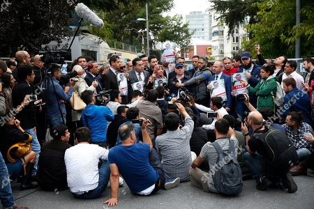 Tawakkol Karman, centre, of Yemen, the 2011 Nobel Peace Prize laureate, accompanied by other supporters of missing Saudi writer Jamal Khashoggi, talks to members of the media near the Saudi Arabia consulate in Istanbul, . Khashoggi, 59, went missing on Oct 2 while on a visit to the consulate in Istanbul for paperwork to marry his Turkish fiancée. The consulate insists the writer left its premises, contradicting Turkish officials. He had been living since last year in the U.S. in a self-imposed exile, in part due to the rise of Prince Mohammed, the son of King Salman