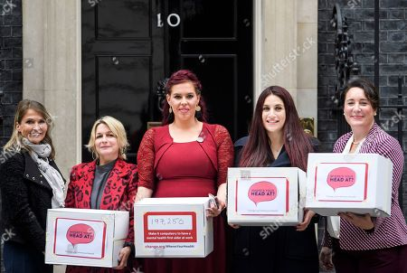 Labour MP Luciana Berger (2R) is joined by campaigner Natasha Devon (Centre) and other campaigners as they hand the Mental Health First Aid England petition, titled 'Where's Your Head At?', at the front door of 10 Downing Street, calling for a law change.