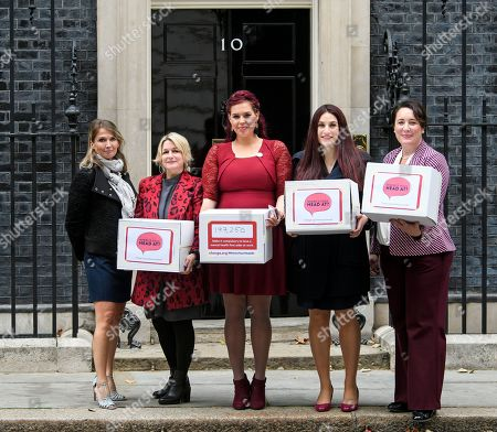 Labour MP Luciana Berger (2R) is joined by campaigner Natasha Devon (Centre) and other campaigners as they hand the Mental Health First Aid England petition titled 'Where's Your Head At?', at the front door of 10 Downing Street, calling for a law change.