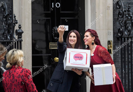 Labour MP Luciana Berger is joined by campaigner Natasha Devon as they hand the Mental Health First Aid England petition titled 'Where's Your Head At?', at the front door of 10 Downing Street, calling for a law change.