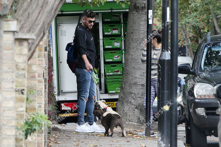 Andrew Brady walking his dogs