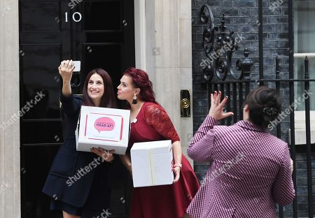 Labour MP Luciana Berger (L) and campaigner Natasha Devon (R) pose for selfie while handing over a petition calling for a law change on Mental Health First Aid, at n10 Downing street in London, Britain, 08 October 2018.