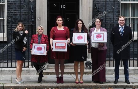 Labour MP Luciana Berger (3-R) and campaigner Natasha Devon (3-L) pose for selfie while handing over a petition calling for a law change on Mental Health First Aid, at n10 Downing street in London, Britain, 08 October 2018.