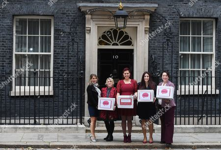 Labour MP Luciana Berger (2-R) and campaigner Natasha Devon (C) pose for selfie while handing over a petition calling for a law change on Mental Health First Aid, at n10 Downing street in London, Britain, 08 October 2018.